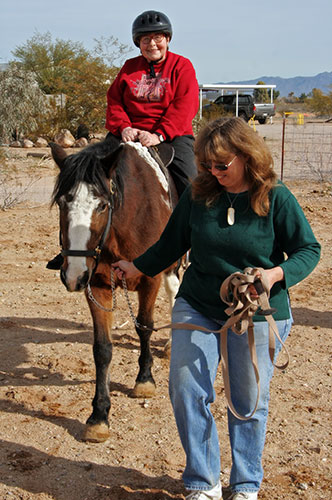 Oma Jutta riding a horse at Chile Acres in Tonopah, Arizona