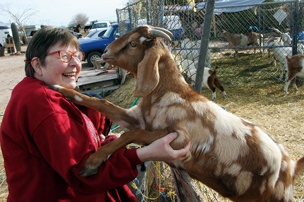 Jutta Engelhardt and a goat from Chile Acres in Tonopah, Arizona