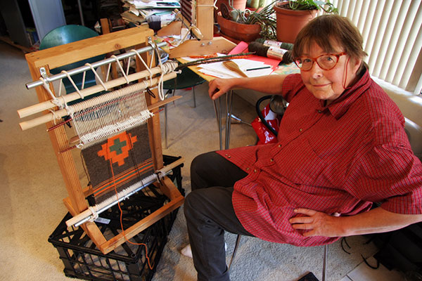 Jutta Engelhardt working on a loom making a Navajo Rug in Phoenix, Arizona